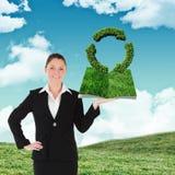 Sammansatt bild av den hållande gräsmattaboken för kvinna Arkivfoton