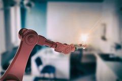 Sammansatt bild av den illustrativa bilden av den hållande glödtråden 3d för robotic hand Royaltyfri Fotografi