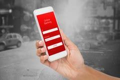 Sammansatt bild av den kantjusterade bilden av den smarta telefonen för affärskvinnainnehav Royaltyfri Bild