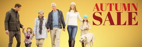 Sammansatt bild av den lyckliga familjen som går med deras hund royaltyfri fotografi