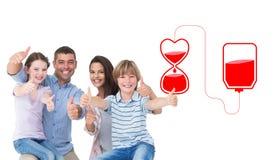 Sammansatt bild av den lyckliga familjen som gör en gest upp tummar Royaltyfri Fotografi