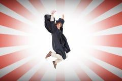 Sammansatt bild av den lyckliga manliga studenten i doktorand- ämbetsdräktbanhoppning Royaltyfri Fotografi