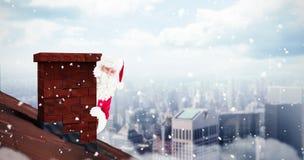 Sammansatt bild av den lyckliga Santa Claus hållande affischen Royaltyfria Foton