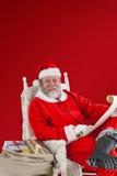 Sammansatt bild av den lyckliga Santa Claus innehavsnirkeln Arkivbilder