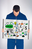 Sammansatt bild av den manuella arbetaren som visar en bok Arkivbild