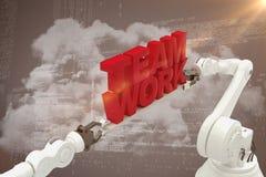 Sammansatt bild av den robotic handen som rymmer röd lagarbetstext Royaltyfria Bilder