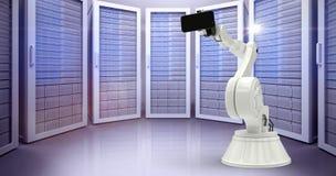 Sammansatt bild av den sammansatta bilden av den hållande mobiltelefonen 3d för robot Fotografering för Bildbyråer