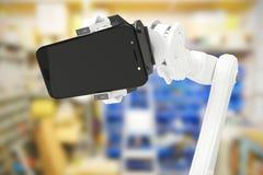 Sammansatt bild av den sammansatta bilden av den hållande mobiltelefonen 3d för robot Arkivfoton