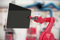 Sammansatt bild av den sammansatta bilden av den röda roboten som rymmer den digitala minnestavlan 3d Arkivbilder