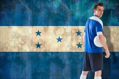 Sammansatt bild av den stiliga fotbollsspelaren i blå ärmlös tröja Royaltyfria Foton