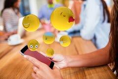 Sammansatt bild av den tredimensionella bilden av grundläggande emoticons 3d Arkivfoto