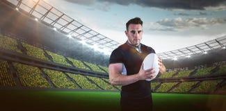 Sammansatt bild av den tuffa rugbyspelaren som ser kameran 3D Royaltyfria Foton