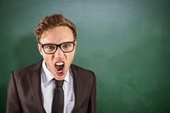 Sammansatt bild av den unga ilskna affärsmannen som ropar på kameran Royaltyfria Bilder