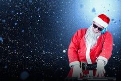 Sammansatt bild av det blandande ljudet för dj Santa Claus Royaltyfri Bild