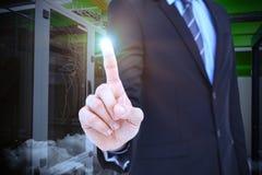 Sammansatt bild av det mitt- avsnittet av affärsmannen som pekar upp något Arkivfoton