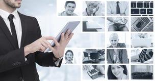 Sammansatt bild av det mitt- avsnittet av en affärsman som använder digital minnestavlaPC royaltyfria bilder