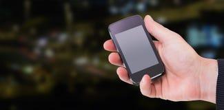 Sammansatt bild av det mitt- avsnittet av en hållande smartphone 3d för affärsman Royaltyfri Foto