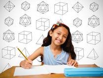 Sammansatt bild av eleven på hennes skrivbord Royaltyfria Foton