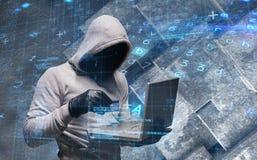 Sammansatt bild av en hacker som använder bärbara datorn för att stjäla identitet fotografering för bildbyråer