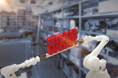 Sammansatt bild av för lagarbete för robotic hand det hållande meddelandet mot vit bakgrund Arkivbilder