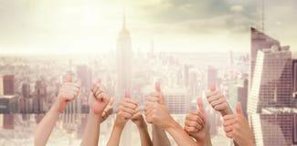 Sammansatt bild av gruppen av händer som ger upp tummar Royaltyfria Foton