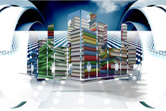 Sammansatt bild av högar av böcker på den abstrakta skärmen Arkivbilder