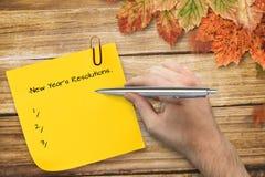 Sammansatt bild av handen som rymmer en silverpenna Fotografering för Bildbyråer
