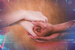 Sammansatt bild av kantjusterade händer som tillsammans rymmer Arkivbilder