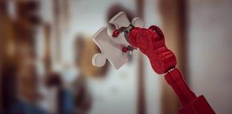 Sammansatt bild av kantjusterat av det röda robotic stycket 3d för handinnehavpussel Arkivfoton