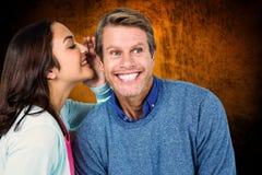 Sammansatt bild av kvinnan som delar hemlighet med mannen Fotografering för Bildbyråer