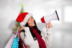 Sammansatt bild av kvinnan som rymmer några shoppingpåsar Arkivfoton