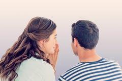 Sammansatt bild av kvinnan som viskar hemlighet till pojkvännen Royaltyfri Fotografi