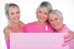 Sammansatt bild av kvinnor som bär rosa färgblast och band för bröstcancer Fotografering för Bildbyråer