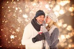 Sammansatt bild av lyckliga par som skvallrar, medan dricka varmt te Royaltyfria Bilder