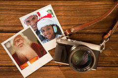 Sammansatt bild av lyckliga santa som rymmer en glödande gåva Arkivbild