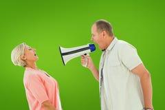 Sammansatt bild av mannen som ropar på hans partner till och med megafonen Royaltyfria Foton