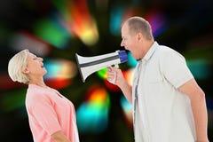 Sammansatt bild av mannen som ropar på hans partner till och med megafonen Royaltyfri Fotografi