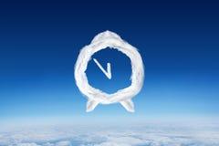 Sammansatt bild av molnringklockan Arkivbild