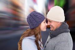 Sammansatt bild av par i varma kläder som vänder mot sig Royaltyfria Bilder