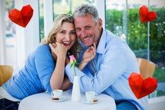 Sammansatt bild av par som dricker kaffe och hjärtor 3d Fotografering för Bildbyråer