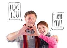 Sammansatt bild av par som gör en hjärta att forma Arkivbild