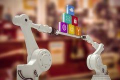 Sammansatt bild av robotic händer som rymmer datorsymboler över vit bakgrund Arkivfoton