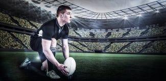 Sammansatt bild av rugbyspelaren som är klar att göra en droppspark med 3d Arkivfoto