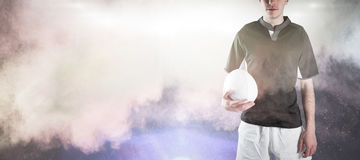 Sammansatt bild av rugbyspelaren som rymmer en rugbyboll Royaltyfria Foton
