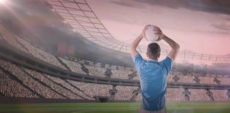 Sammansatt bild av rugbyspelaren som rymmer en rugbyboll 3D Royaltyfria Bilder