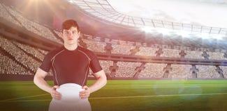 Sammansatt bild av rugbyspelaren som rymmer en rugbyboll 3D Arkivbild
