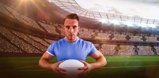 Sammansatt bild av rugbyspelaren som ser kameran 3D Royaltyfri Foto