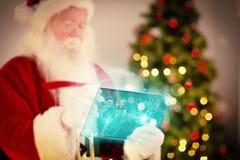 Sammansatt bild av santa som kontrollerar hans lista Fotografering för Bildbyråer
