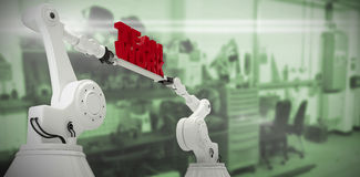 Sammansatt bild av sikten för låg vinkel av för lagarbete för vit robotic hand hållande text Arkivfoto