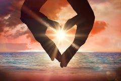 Sammansatt bild av slutet upp av händer som bildar hjärta Royaltyfri Fotografi
